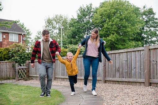 istock Happy Family Walking Together 1051324124