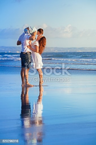 497142294 istock photo Happy family walking with fun on sunset sea beach 520296316