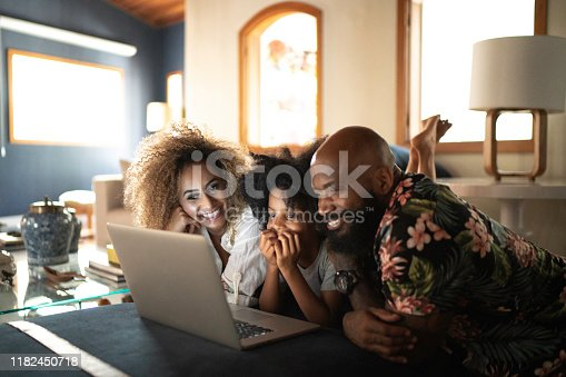 Happy family watching movie on a laptop