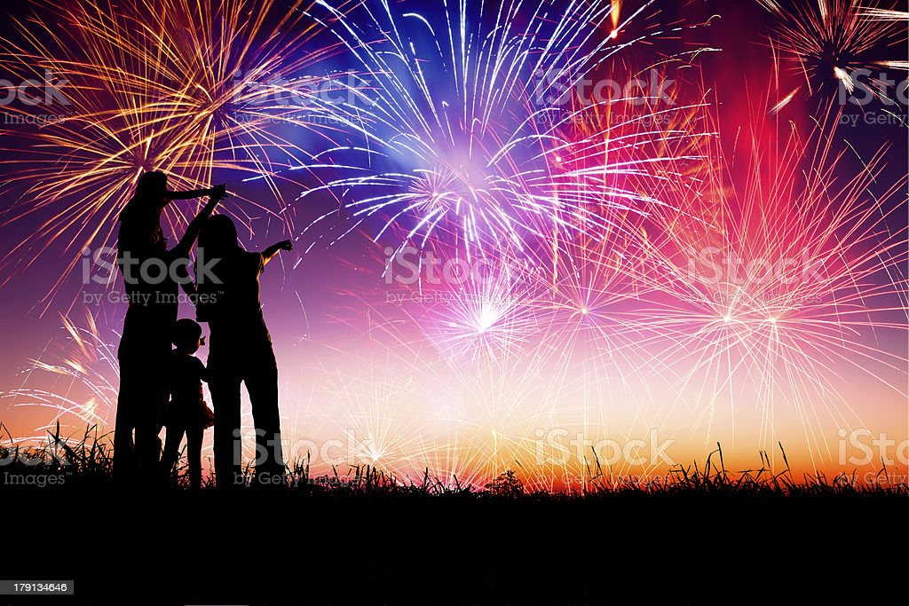 happy family  watching the fireworks stock photo