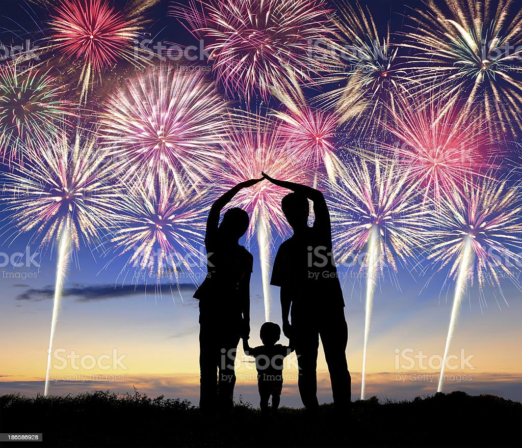 happy family watching the fireworks royalty-free stock photo