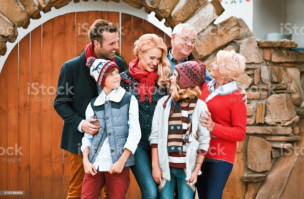 Happy family, Winter Portrait Happy multi-generation family wearing winter clothes standing outdoor and having fun. Active Seniors Stock Photo