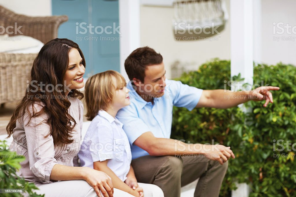 Happy family with a man pointing at something interesting royalty-free stock photo