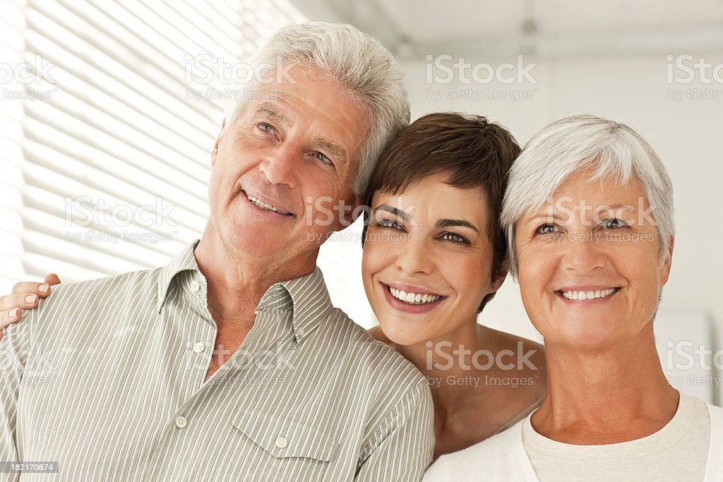 Happy family with arm around royalty-free stock photo