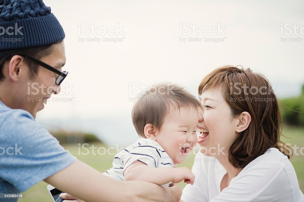 Happy family with baby boy. stock photo