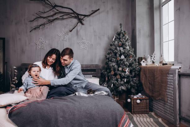 Happy family with baby girl. Christmas mood. stock photo