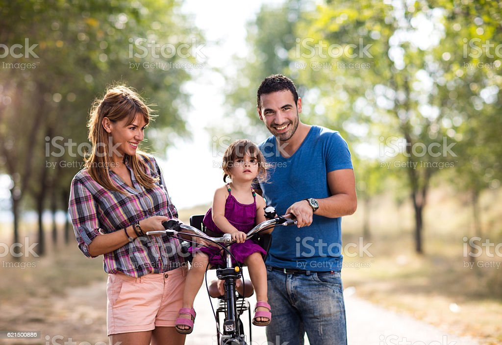 Happy family with bicycle spending day in nature. foto stock royalty-free