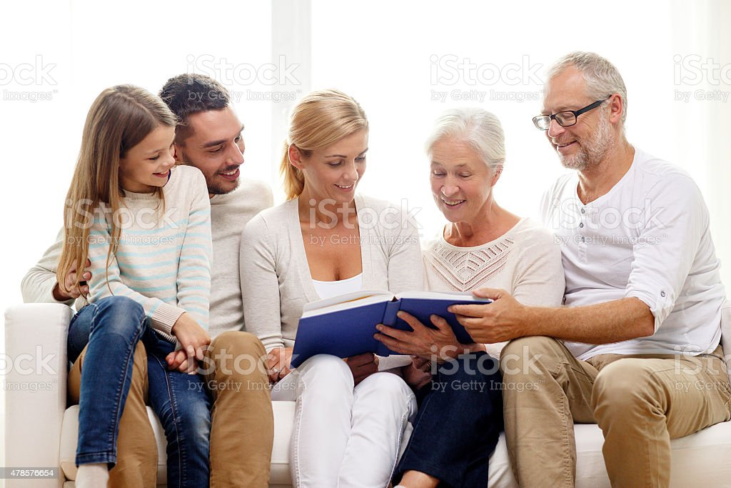 happy family with book or photo album at home royalty-free stock photo
