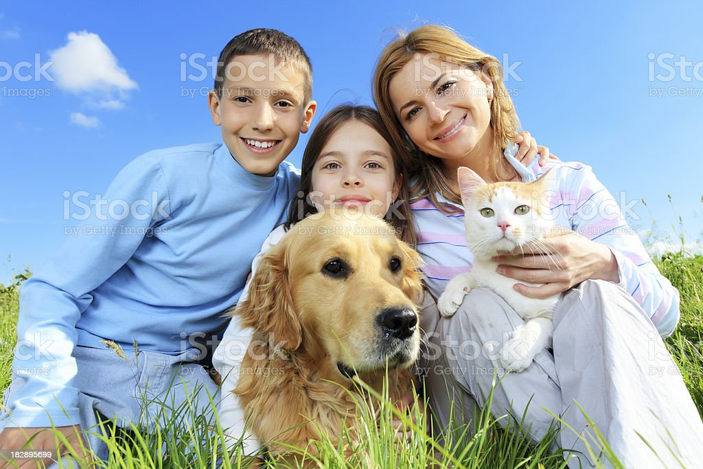 Happy family with cat and dog looking at camera. royalty-free stock photo