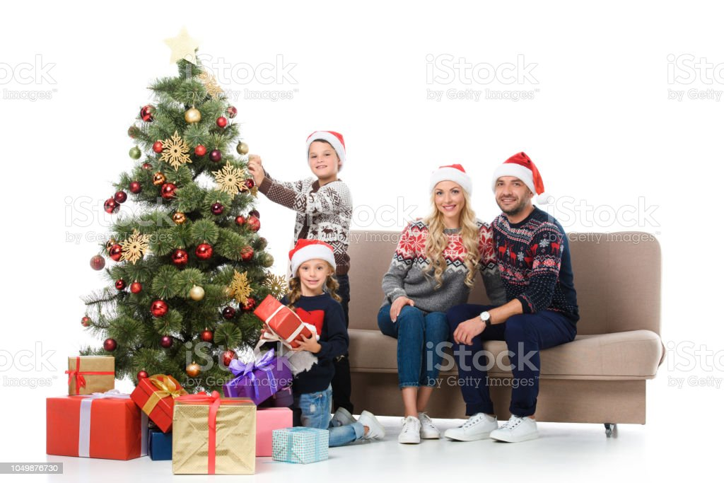 Happy Family With Children Near Christmas Tree With ...