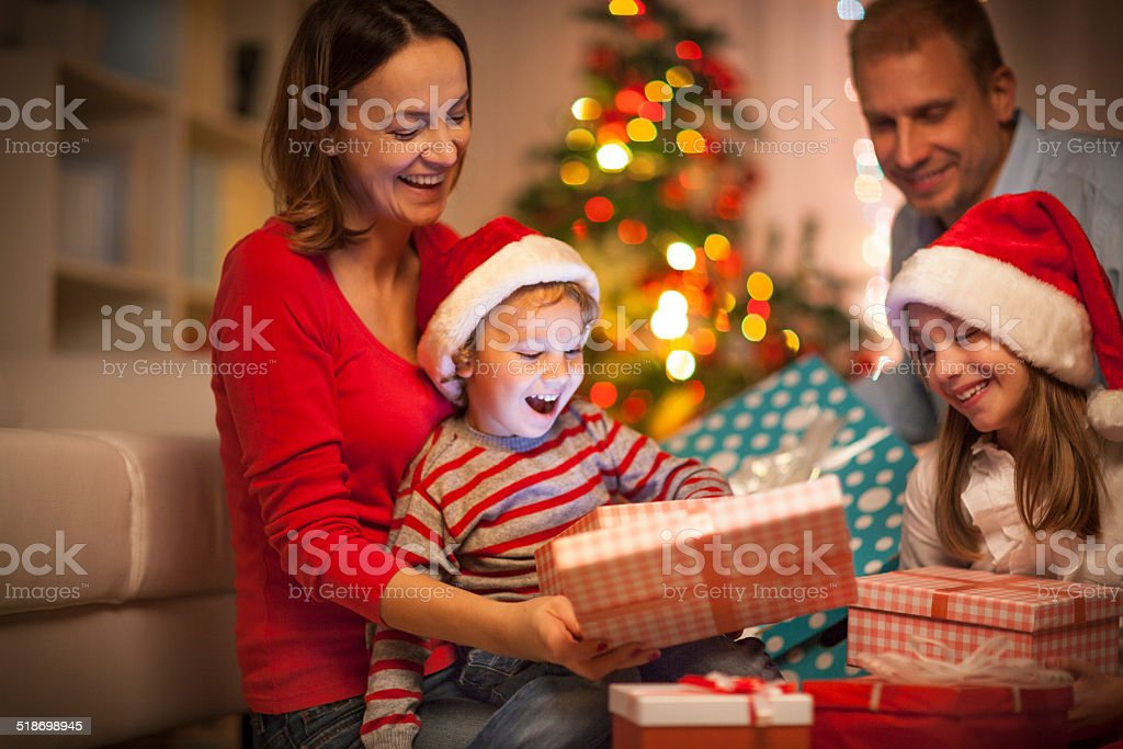 Happy family with Christmas gifts stock photo
