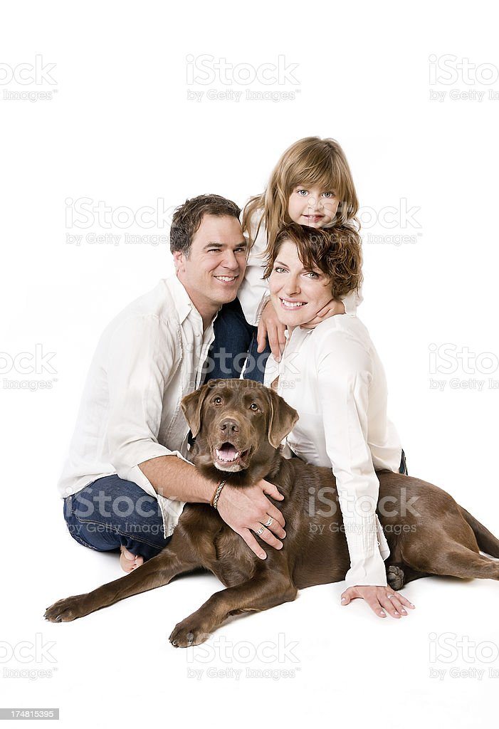Happy Family with Cute Chocolate Labrador Retriever Dog royalty-free stock photo