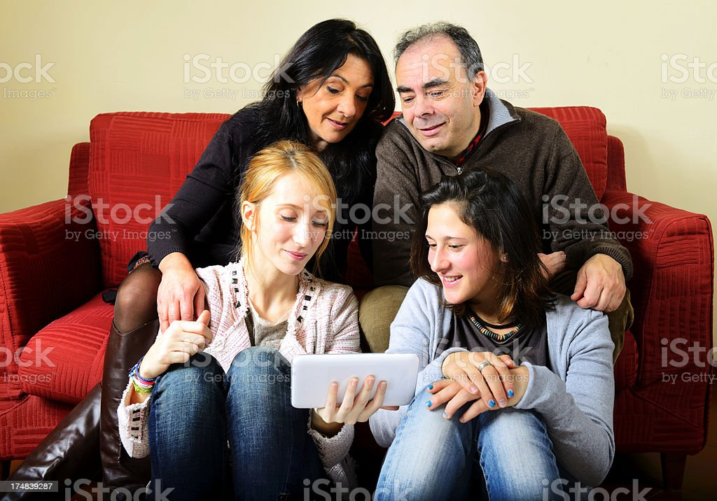 Happy Family with Digital Tablet on Sofà royalty-free stock photo