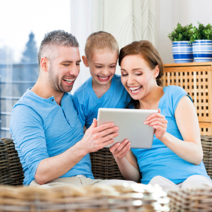 871175856 istock photo Happy Family with digital tablet 174765436