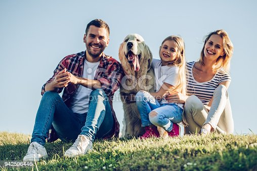 942596618 istock photo Happy family with dog 942596446