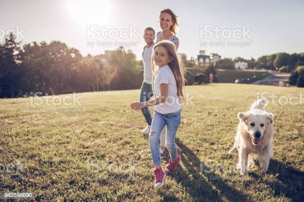 Happy family with dog picture id942596690?b=1&k=6&m=942596690&s=612x612&h= ec6dcpmp6esgmfottpbh47qqhoorcewy12lv6 6ndy=