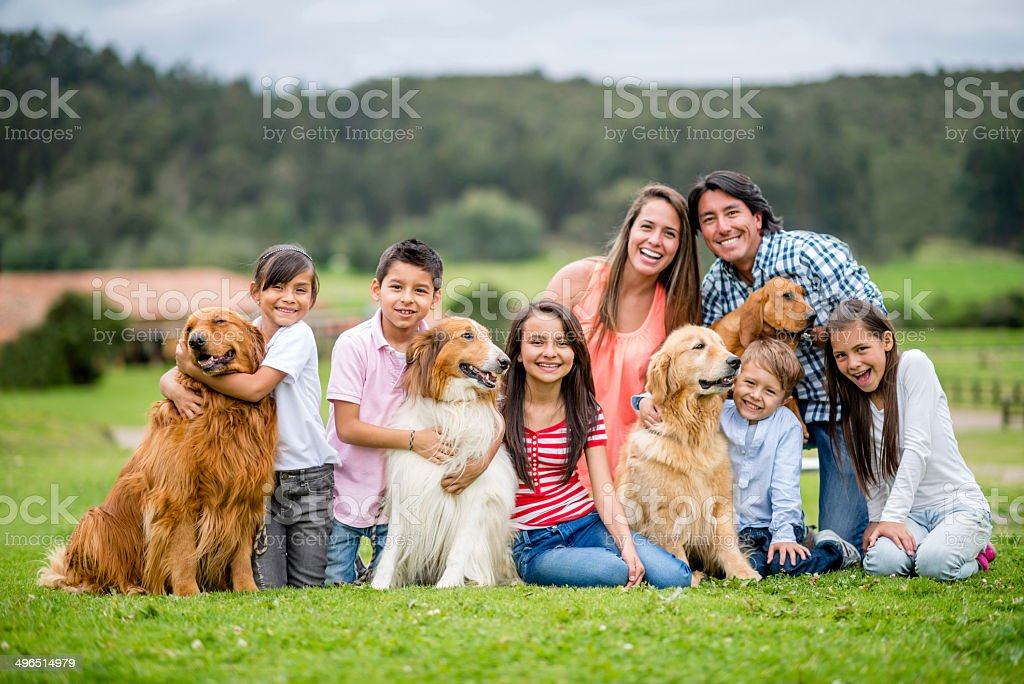 Happy family with dogs stock photo