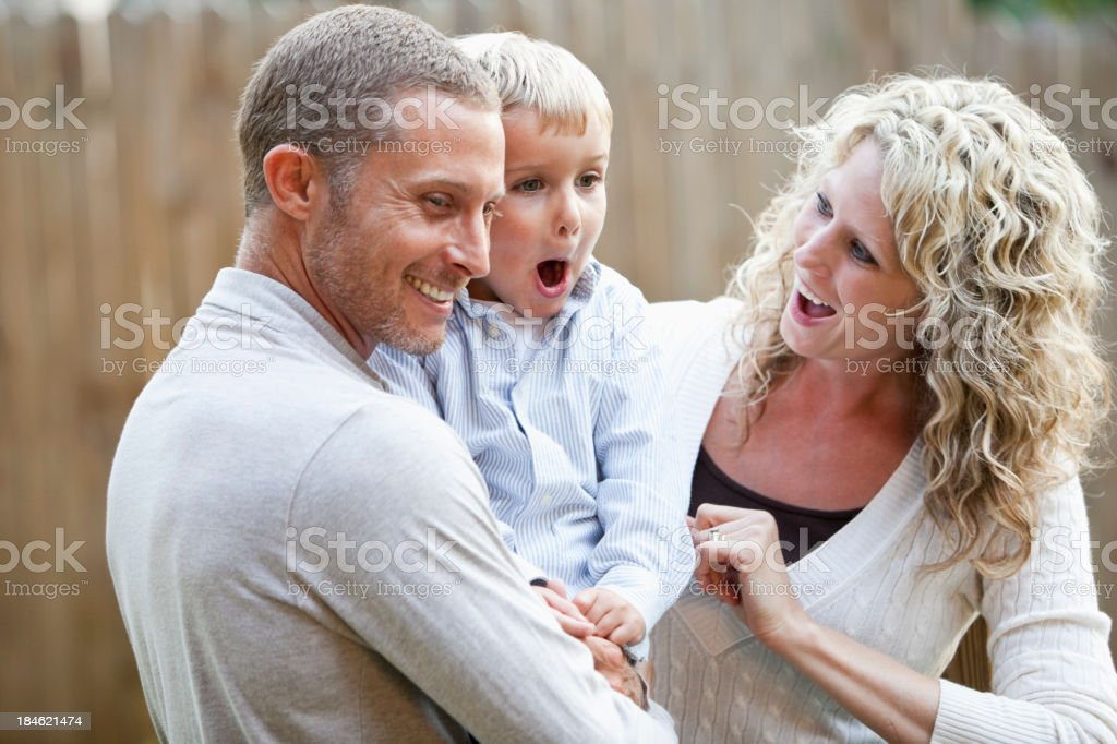 Happy family with excited little boy royalty-free stock photo