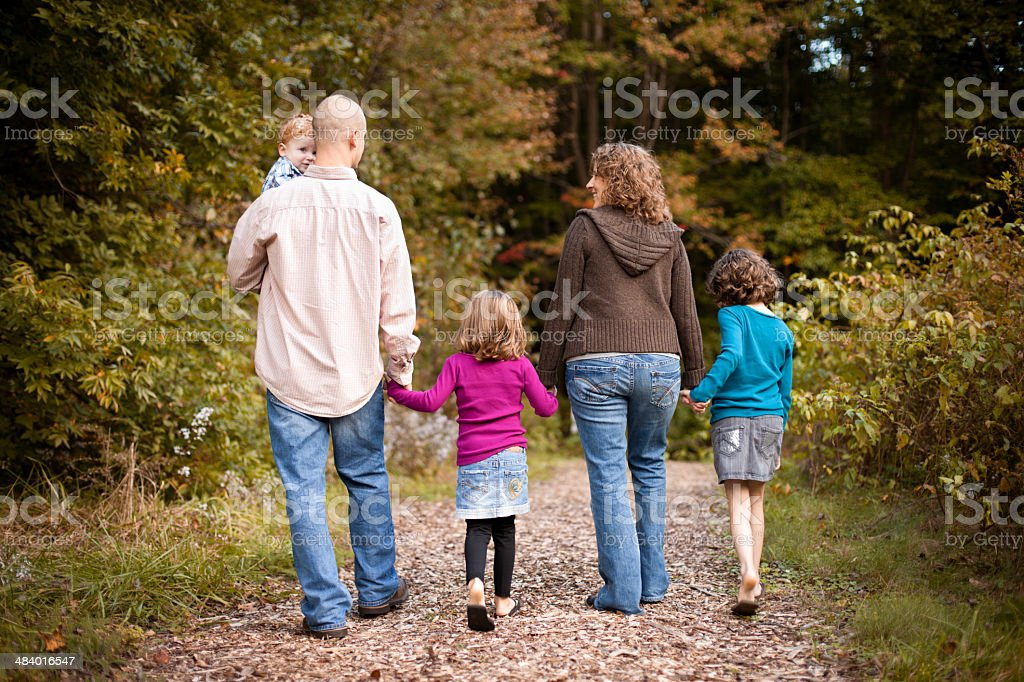 Happy Family with Father, Mother, Daughters and Son, in Woods royalty-free stock photo