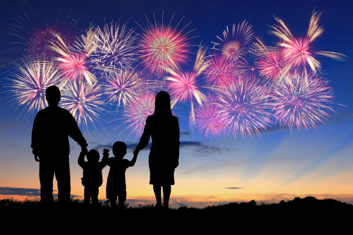 silhouette of happy family with fireworks