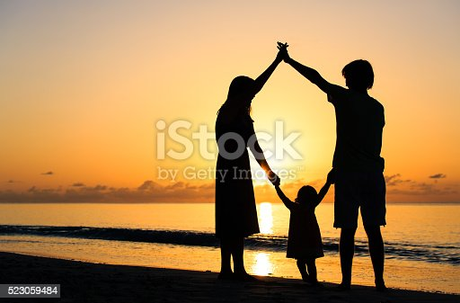 605742160 istock photo happy family with kid having fun at sunset 523059484