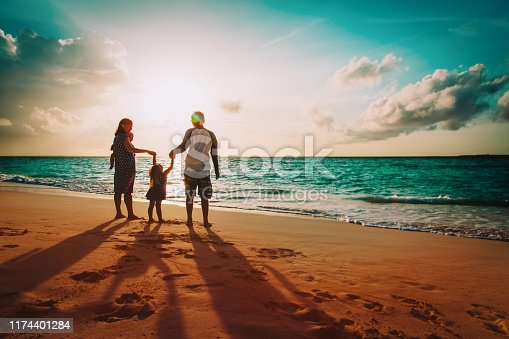 happy family with kids on play on sunset beach, mom, dad and kids on vacation