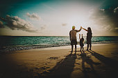 happy family with kids play at sunset beach vacationhappy family with kids play at sunset beach vacation