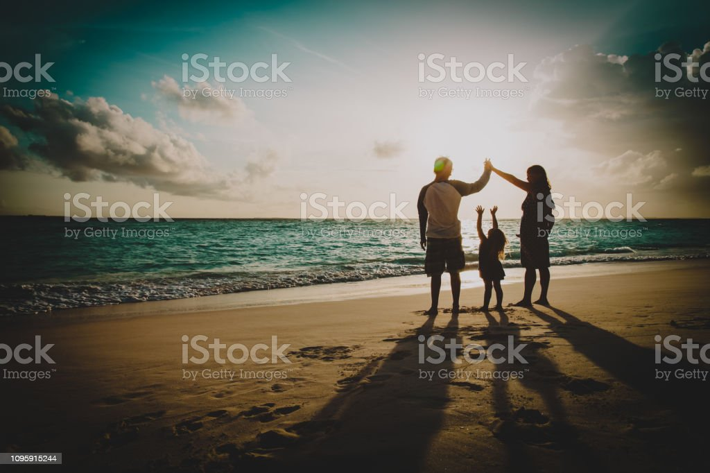 happy family with kids play at sunset beach stock photo