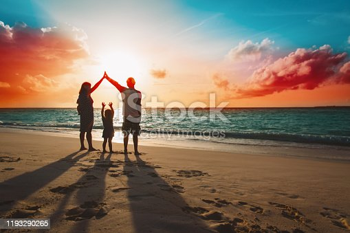 happy family with kids play at sunset tropical beach