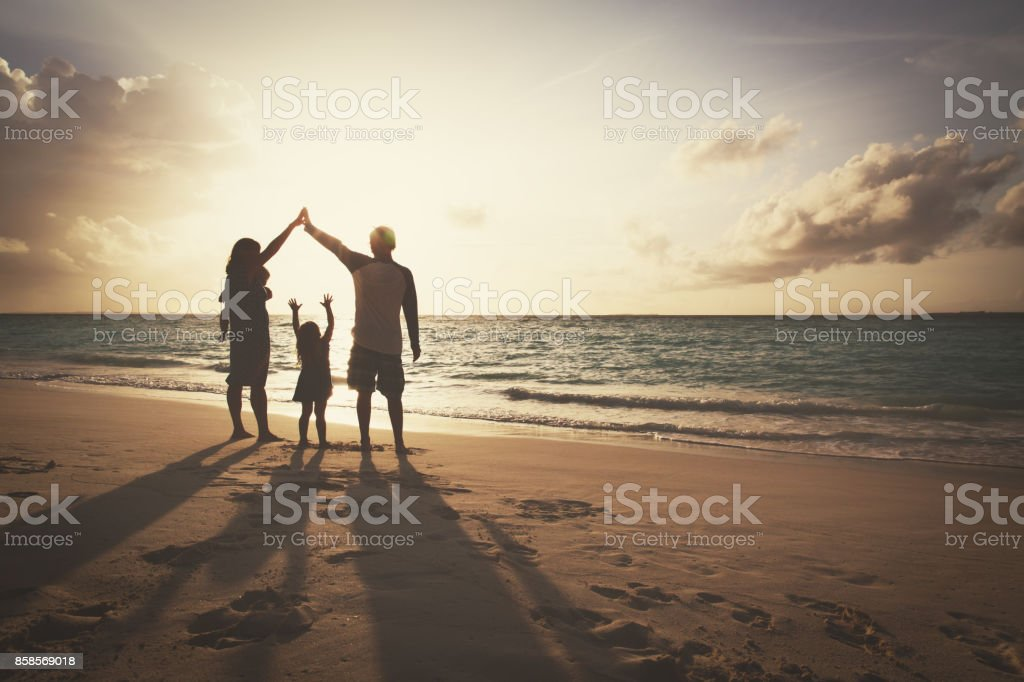 happy family with kids play at sunset beach royalty-free stock photo