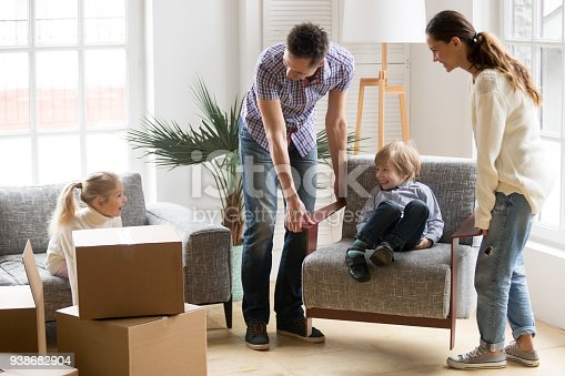 istock Happy family with kids playing on moving day at home 938682904