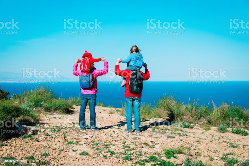 happy family with kids travel hiking in mountains at sea zbiór zdjęć royalty-free