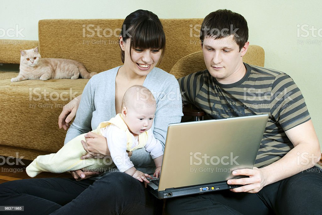 happy family with laptop royalty-free stock photo