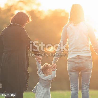 istock Happy family with mother, daughter and grandma outdoor. Fall season 612747382