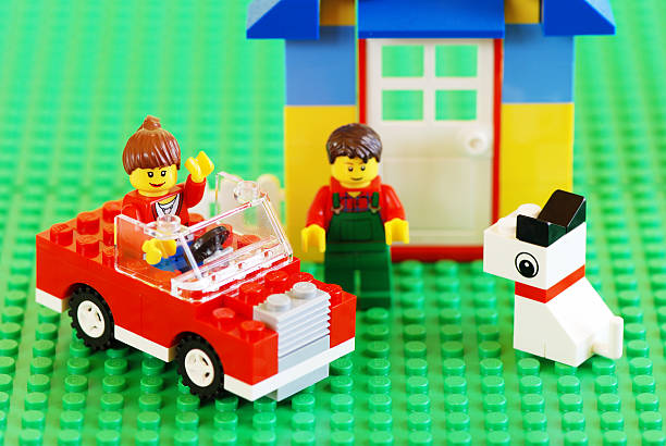 happy family with new car, house and dog - lego house stock photos and pictures