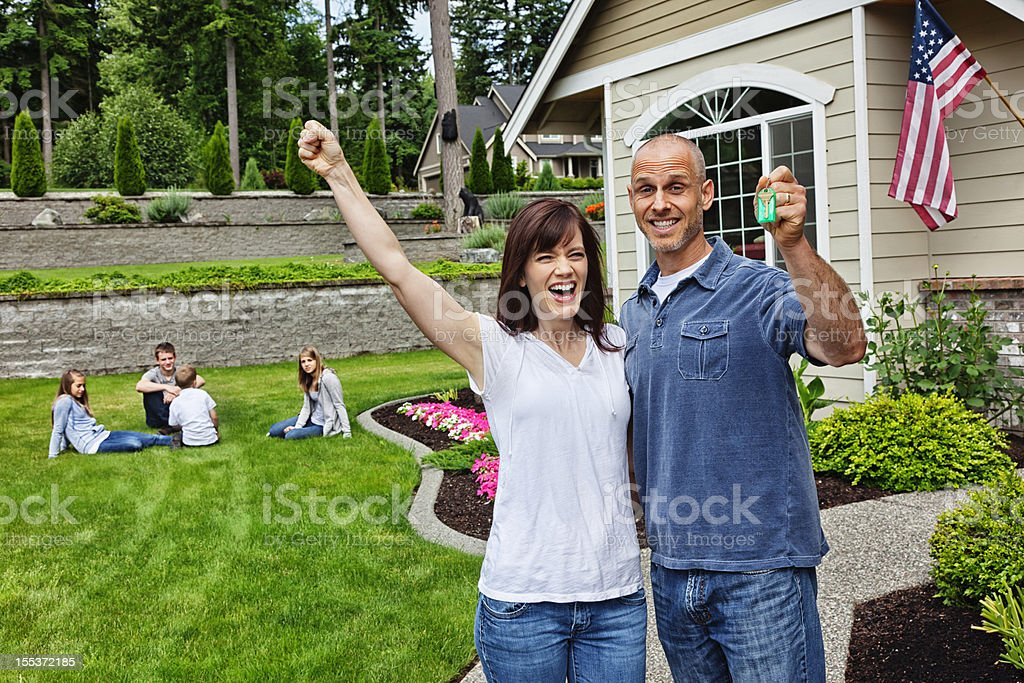 Happy Family with New Home royalty-free stock photo