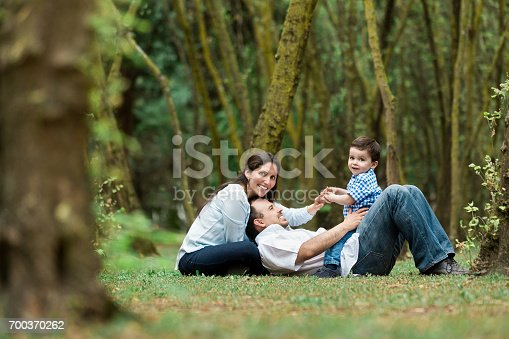 811227514 istock photo Happy family with one boy spending time outdoors 700370262