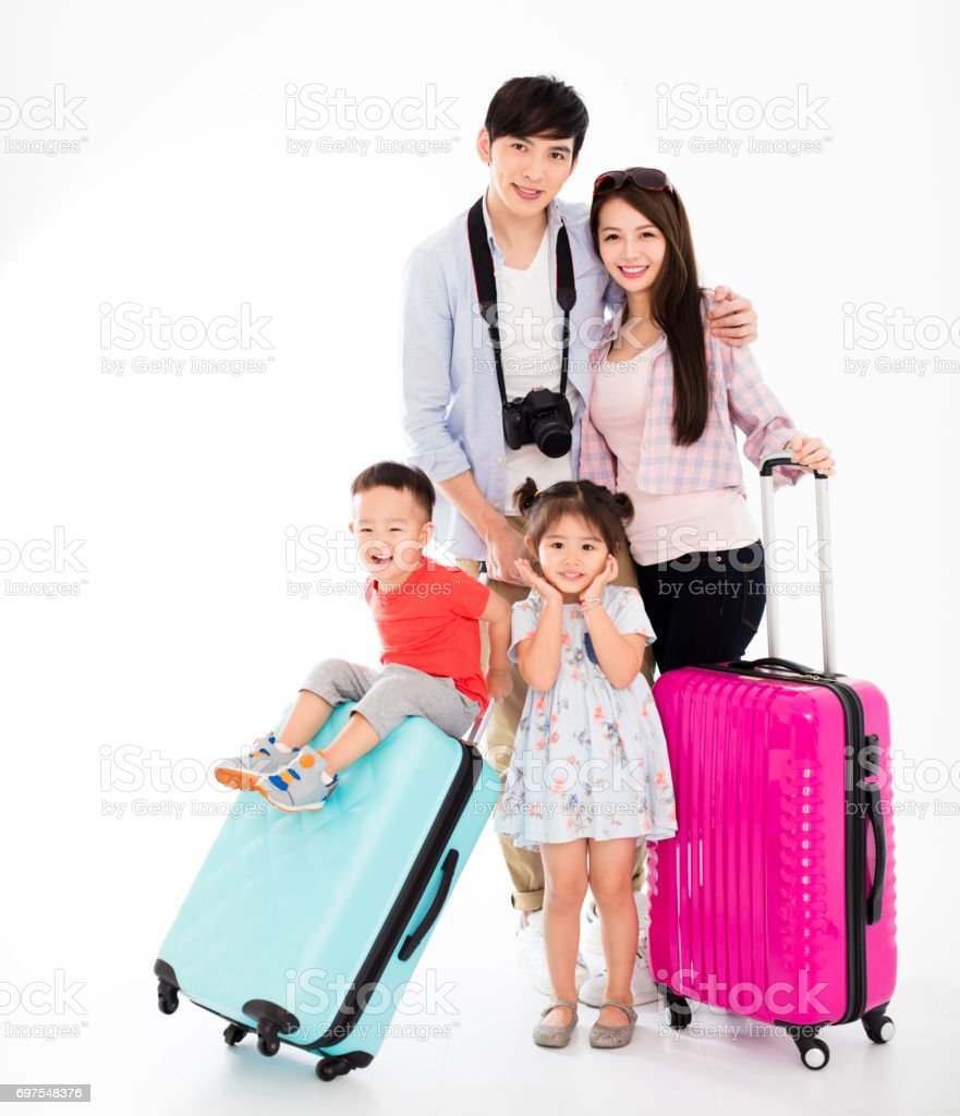 happy family with suitcase going on vacation stock photo