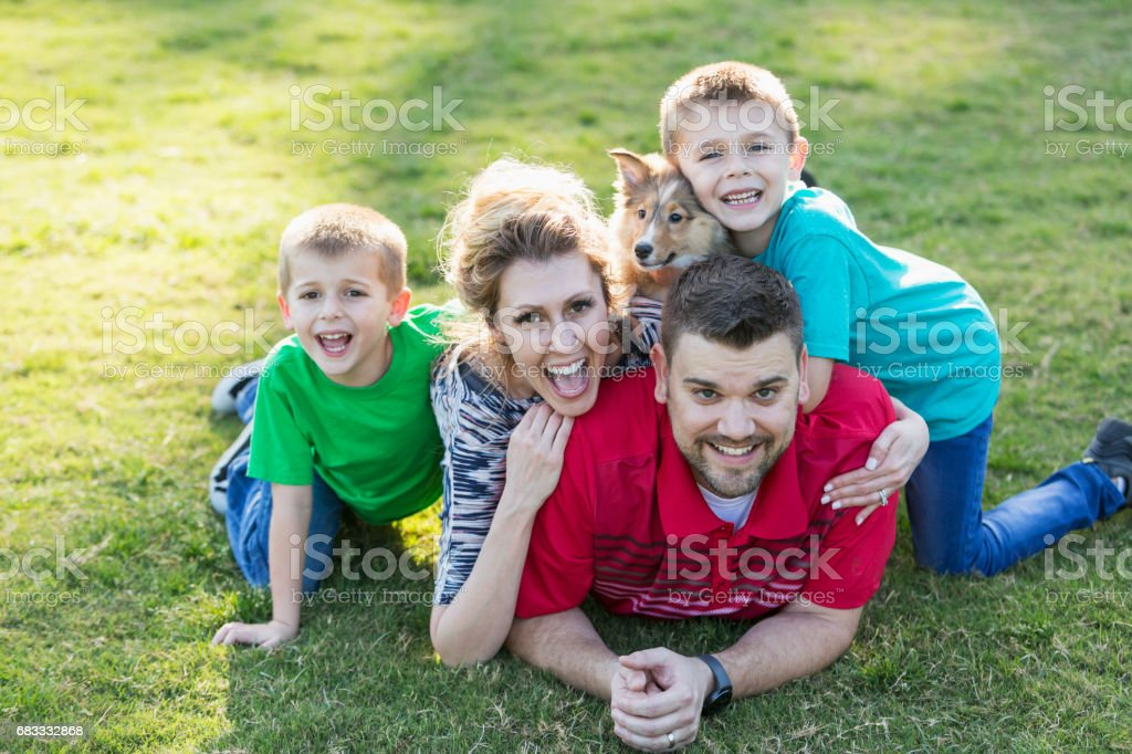 Happy family with two children and dog in stack royalty-free stock photo