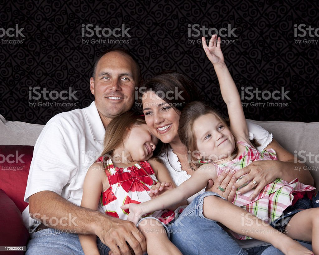 Happy Family with Two Children Playing on Sofa royalty-free stock photo