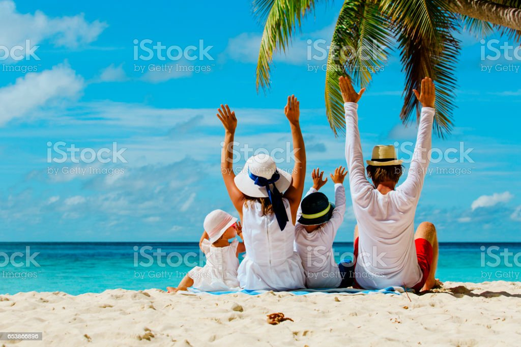 happy family with two kids hands up on beach - fotografia de stock