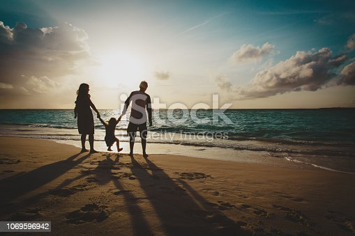 istock happy family with two kids on play on sunset beach 1069596942