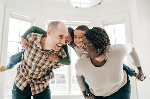 639403466 istock photo Happy family with two kids 1159099848