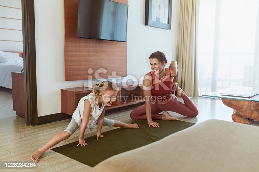 916126642 istock photo Happy Family. Workout Exercise At Home. Happy Mother And Daughter Stretching Together In Living Room. Little Girl And Young Woman Having Fun. 1226234264