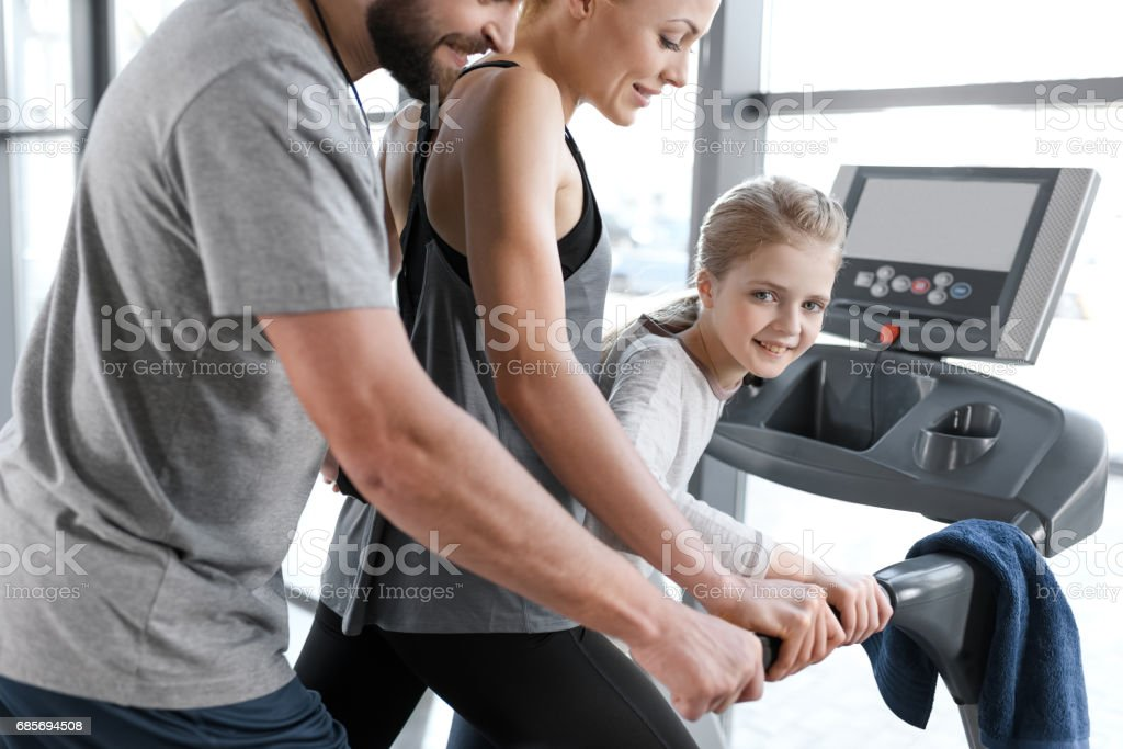 Happy family workout on treadmill, side view royalty-free 스톡 사진