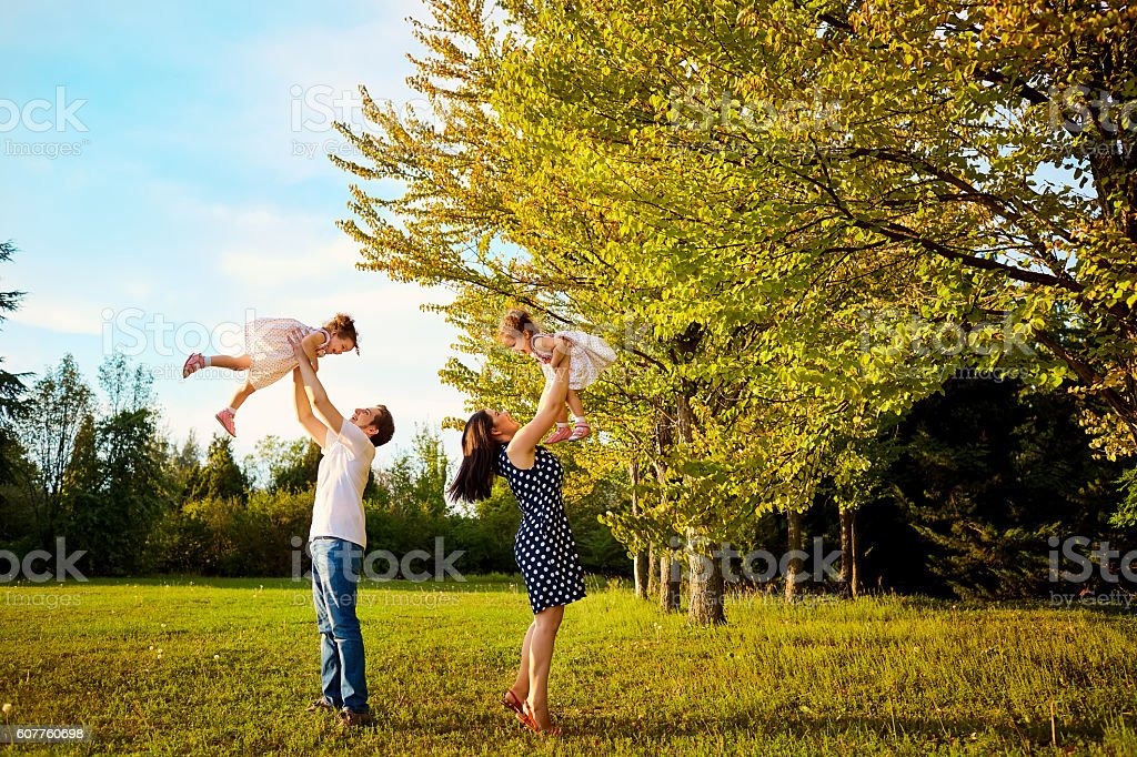 Happy familyn the park outdoors in summer, autumn. stock photo