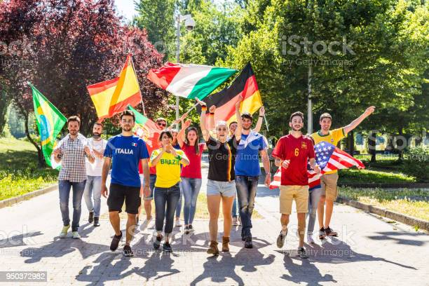 Happy fans supporters from different countries walking and chanting picture id950372982?b=1&k=6&m=950372982&s=612x612&h=g5shsh5wmyy um98ljllrnihuyxikkmmqhzwmpxke7a=