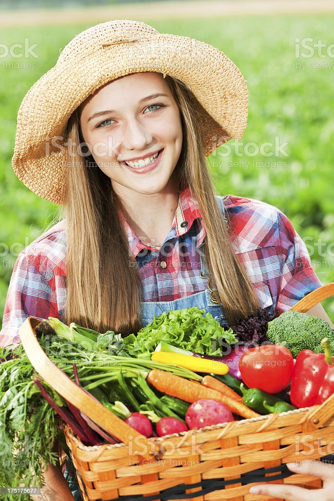 Happy Farm Girl with Basket of Freshly Harvested Produce Close-up royalty-free stock photo