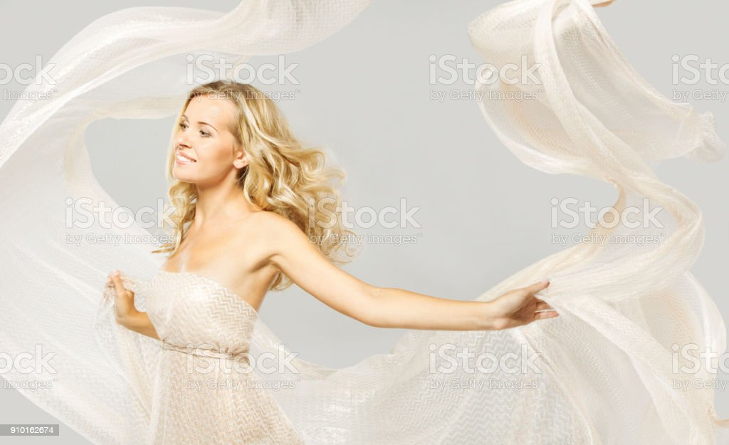 Happy Fashion Model in White Dress, Woman Beauty Portrait, Elegant Girl Dancing With Flying Fabric stock photo