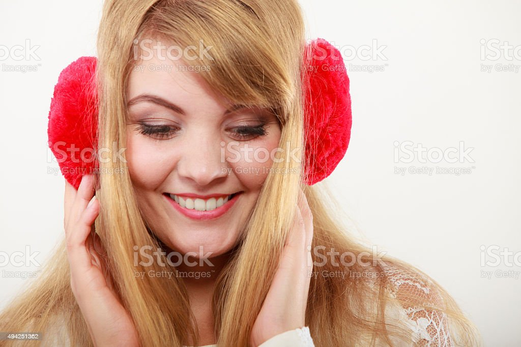 Happy fashionable girl in red earmuffs stock photo